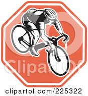 Royalty Free RF Clipart Illustration Of A Bicyclist On A Stop Sign Logo by patrimonio