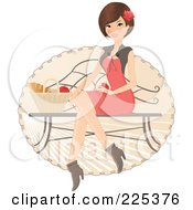 Pretty Brunette Woman Sitting On A Bench With A Picnic Basket Of Food