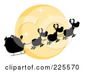 Royalty Free RF Clipart Illustration Of A Silhouette Of Santa And Magic Reindeer In Front Of A Full Yellow Moon by Hit Toon