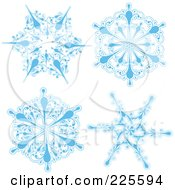 Royalty Free RF Clipart Illustration Of A Digital Collage Of Ornate Icy Blue And White Snowflake Design by KJ Pargeter