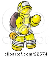 Yellow Fireman In A Uniform Fighting A Fire