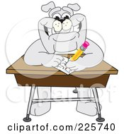 Gray Bulldog Mascot Doing Homework At A School Desk