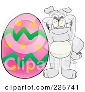 Royalty Free RF Clipart Illustration Of A Gray Bulldog Mascot With A Giant Easter Egg by Toons4Biz