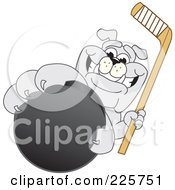 Royalty Free RF Clipart Illustration Of A Gray Bulldog Mascot Reaching Up And Grabbing A Hockey Puck by Toons4Biz