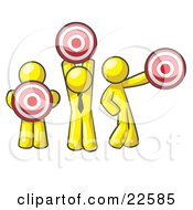 Group Of Three Yellow Men Holding Red Targets In Different Positions by Leo Blanchette