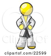 Tough Yellow Man In A White Karate Suit And A Black Belt Standing With His Hands On His Hips