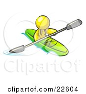 Yellow Man Paddling Down A River In A Green Kayak