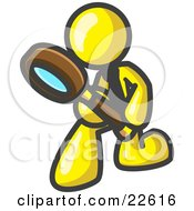 Yellow Man Bending Over To Inspect Something Through A Magnifying Glass
