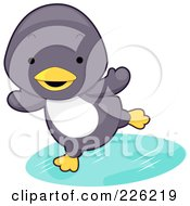 Royalty Free RF Clipart Illustration Of A Cute Baby Penguin Playing On Ice