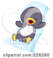 Royalty Free RF Clipart Illustration Of A Cute Baby Penguin On An Ice Slide by BNP Design Studio