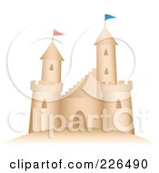 Sand Castle With Flags On The Turrets