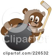Royalty Free RF Clipart Illustration Of A Bear Cub School Mascot Grabbing A Hockey Puck