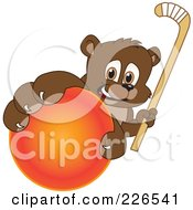 Royalty Free RF Clipart Illustration Of A Bear Cub School Mascot Grabbing A Hockey Ball And Holding A Stick