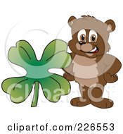 Royalty Free RF Clipart Illustration Of A Bear Cub School Mascot With A Four Leaf Clover by Toons4Biz