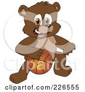 Royalty Free RF Clipart Illustration Of A Bear Cub School Mascot Playing Basketball by Toons4Biz