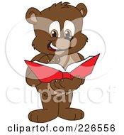 Royalty Free RF Clipart Illustration Of A Bear Cub School Mascot Reading A Book by Toons4Biz