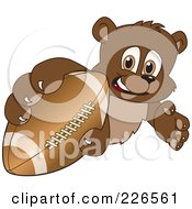 Royalty Free RF Clipart Illustration Of A Bear Cub School Mascot Grabbing A Football