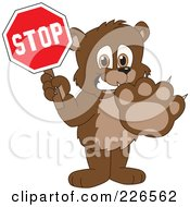Royalty Free RF Clipart Illustration Of A Bear Cub School Mascot Holding A Stop Sign by Toons4Biz