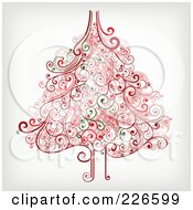 Royalty Free RF Clipart Illustration Of A Red And Green Christmas Tree With Swirl Flourishes 1 by OnFocusMedia