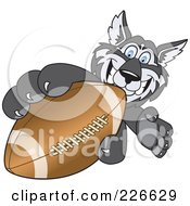 Royalty Free RF Clipart Illustration Of A Husky School Mascot Grabbing A Football by Toons4Biz