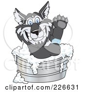Royalty Free RF Clipart Illustration Of A Husky School Mascot Using Soap In A Metal Tub by Toons4Biz