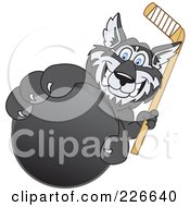 Royalty Free RF Clipart Illustration Of A Husky School Mascot Grabbing A Hockey Puck