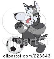 Husky School Mascot Playing Soccer