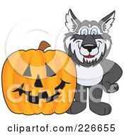 Royalty Free RF Clipart Illustration Of A Husky School Mascot With A Halloween Pumpkin by Toons4Biz
