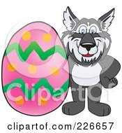 Royalty Free RF Clipart Illustration Of A Husky School Mascot With An Easter Egg by Toons4Biz