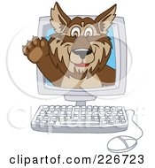 Royalty Free RF Clipart Illustration Of A Wolf School Mascot Waving On A Computer Screen