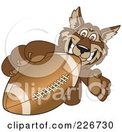 Royalty Free RF Clipart Illustration Of A Wolf School Mascot Grabbing A Football