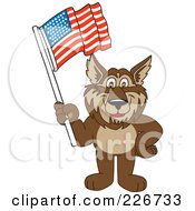 Royalty Free RF Clipart Illustration Of A Wolf School Mascot Waving An American Flag