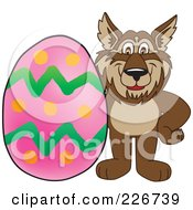 Royalty Free RF Clipart Illustration Of A Wolf School Mascot With An Easter Egg