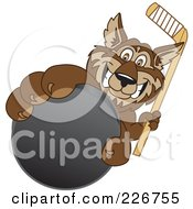 Royalty Free RF Clipart Illustration Of A Wolf School Mascot Grabbing A Hockey Puck by Toons4Biz