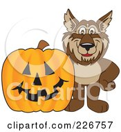 Royalty Free RF Clipart Illustration Of A Wolf School Mascot By A Halloween Pumpkin by Toons4Biz