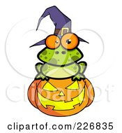 Royalty Free RF Clipart Illustration Of A Spotted Frog Wearing A Witch Hat And Sitting On A Jackolantern by Hit Toon