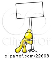 Strong Yellow Man Pushing A Blank Sign Upright by Leo Blanchette
