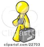 Yellow Male Tourist Carrying His Suitcase And Walking With A Camera Around His Neck