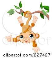 Royalty Free RF Clipart Illustration Of A Cute Baby Monkey Hanging Upside Down by Pushkin