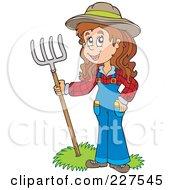 Female Farmer With A Pitchfork