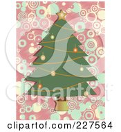 Christmas Tree With Ornaments And A Star Over A Pink And Blue Circle Background