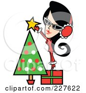 Retro Woman Standing On A Gift And Putting A Star Topper On A Christmas Tree