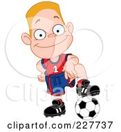 Happy Blond Boy Resting His Foot On A Soccer Ball