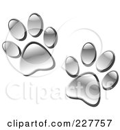 Royalty Free RF Clipart Illustration Of A Pair Of Chrome Paw Prints