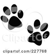 Royalty Free RF Clipart Illustration Of A Pair Of Black Paw Prints