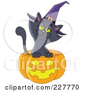 Royalty Free RF Clipart Illustration Of A Happy Black Cat Wearing A Witch Hat And Emerging From A Jackolantern by yayayoyo