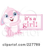Royalty Free RF Clipart Illustration Of A Cute Pink Rabbit Holding An Its A Girl Sign by yayayoyo