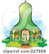 Royalty Free RF Clipart Illustration Of A Cute Frog Living In A Green Gourd House by Lal Perera