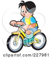 Royalty Free RF Clipart Illustration Of A Boy Riding A Bike by Lal Perera