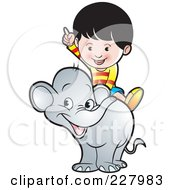 Royalty Free RF Clipart Illustration Of A Boy Riding A Cute Elephant by Lal Perera